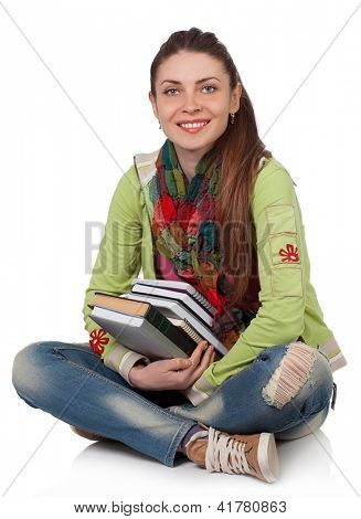 Beautiful student girl sitting with books on a white background