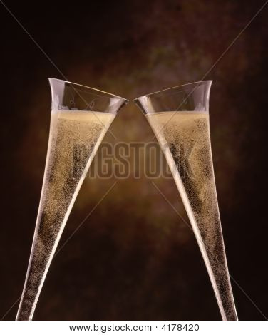Champagne Flutes On A Painted Background Bubbles