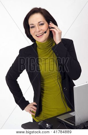 Customer Service Worker In Station On Headset