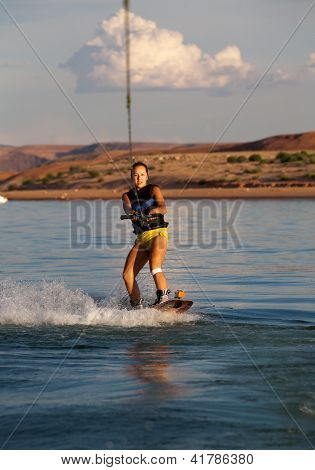 Brunette Wakboarding At Sunset