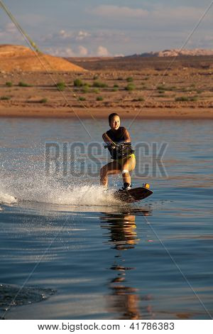 Brunette Teen Wakboarding At Sunset