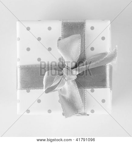 Color gift box with silver ribbon, isolated on white