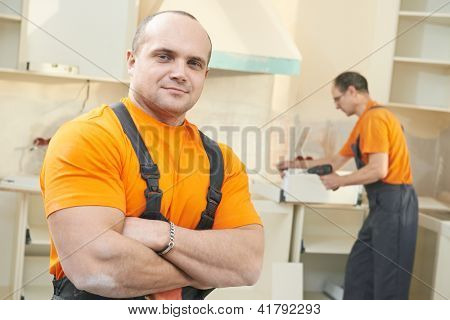 Portraait of Craftsman carpenter at kitchen cabinet installation service work
