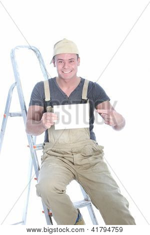 Happy Handyman Pointing To A Blank Card