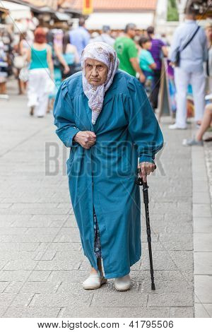 SARAJEVO, BOSNIA - AUGUST 13: Muslim lady in old town on August 13, 2012 in Sarajevo, Bosnia. The city is famous for its religious diversity; Islam, Orthodox, Catholics and Jews coexisting together.