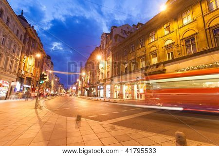 SARAJEVO, BOSNIA - AUGUST 13: Bus passing on Marshal Tito Street at night on August 13, 2012 in Sarajevo, Bosnia. Numerous streets and squares are named after the late Josip Tito.