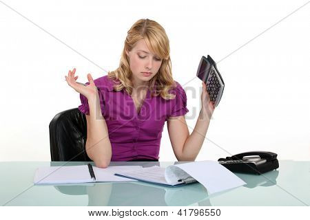 Frustrated woman working out a budget