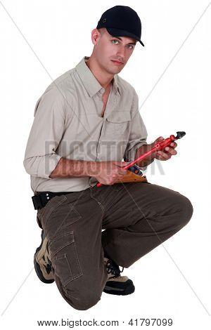 Man with vernier caliper