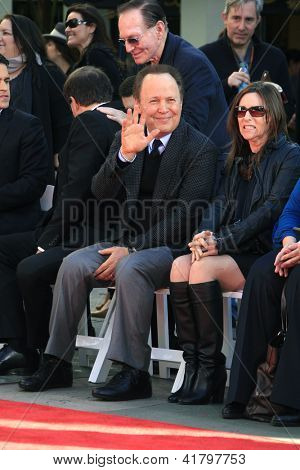 LOS ANGELES, CA - FEB 4: Billy Crystal at a ceremony where Robert De Niro is honored with hand and foot prints at TCL Chinese Theater on February 4, 2013 in Los Angeles, California