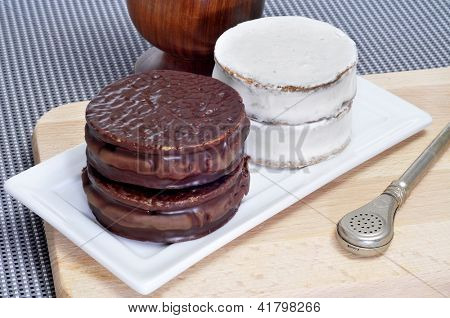 a plate with argentinean-uruguayan alfajores and a mate infusion in a mate recipient