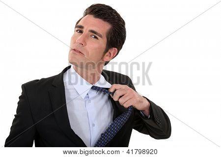 man untying his tie