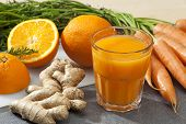 stock photo of ginger  - Glass of fruit juice with orange - JPG