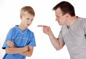 stock photo of mischief  - Strict father punishes his son - JPG