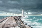 stock photo of coast guard  - Lighthouse at the end of the pier - JPG