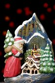 picture of santa-claus  - christmas candle holder with defocused red light bulbs in the background - JPG