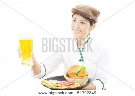Waitress delivering meals to table