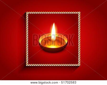 elegant diwali diya enclosed on golden frame