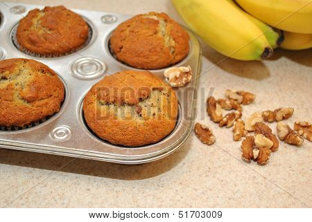 Fresh Banana Nut Muffins Cooling with Ingredients