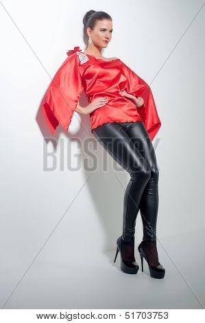 Girl Posing In Red Silk Tunic And Black Leggings