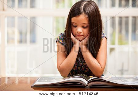 Cute girl reading a storybook