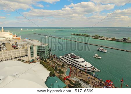 Tourists And Cruise Ships At Navy Pier In Chicago, Illinois