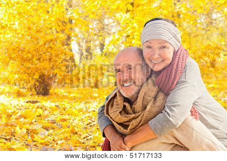 happy autumn fall couple in leaves