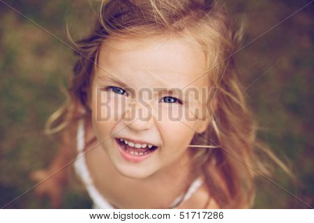 smiling camera looking running child