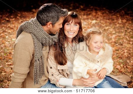 happy autumn fall family in woods
