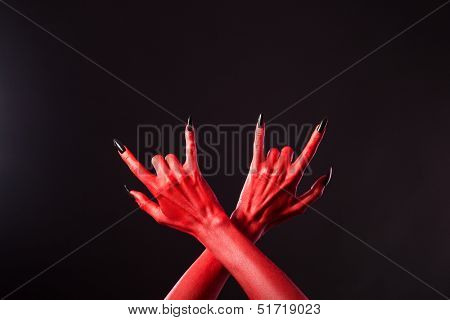 Red devil hands showing heavy metal gesture, Halloween theme