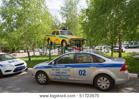 MOSCOW - APR 14: Russias new police cars are on the street next to the pedestal with an old militia car on April 14, 2013 in Moscow, Russia.
