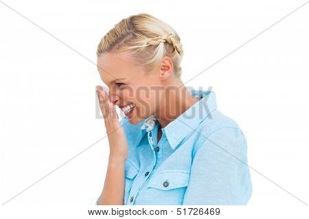 Attractive blonde giggling on white background