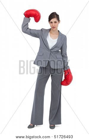 Competitive woman wearing red boxing gloves on white background