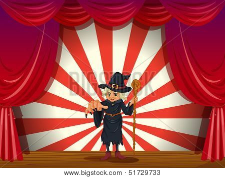 Illustration of a stage with a scary witch in the middle