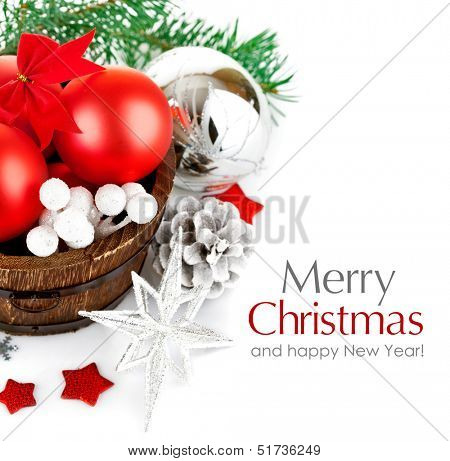 christmas tinsel with branch firtree and red balls isolated on white background