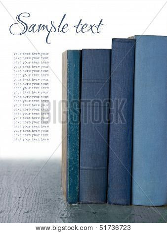 Blue Old Books On Wooden Background