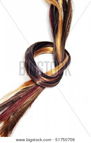 lock of hair of different colors on a white background
