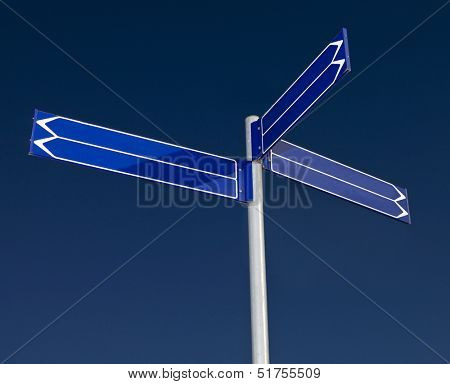 Blank signpost with six arrows against a blue background
