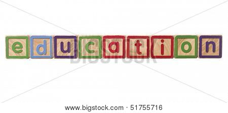 The word education built of Play Blocks isolated on white background