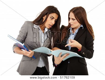 Businesswomen Looking To Documents
