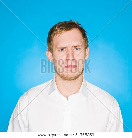 Portrait of a young man on blue background
