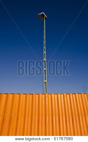Orange Cargo Container towards blue sky