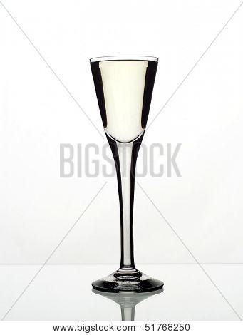 Glass of aquavit isolated on white background