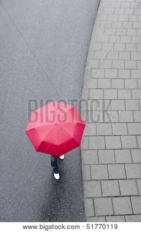Human with red umbrella from hig Angle view