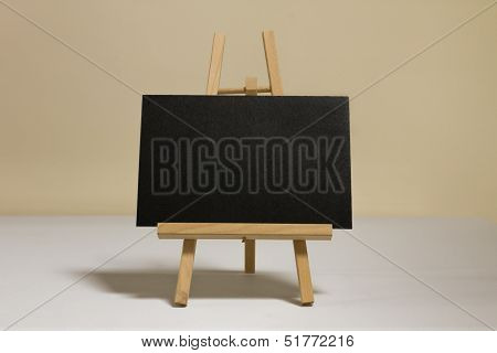 Blackboard placed on a wooden easel