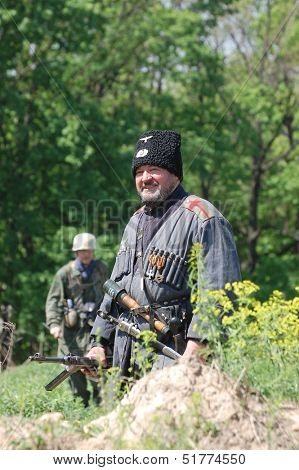 KIEV, UKRAINE -MAY 11: Member of Red Star history club wears historical uniform cossack of Corps von Panvits (German) during historical reenactment of WWII, May 11, 2013 in Kiev, Ukraine