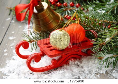 Christmas Composition With Sleigh, Pinecone And Bell