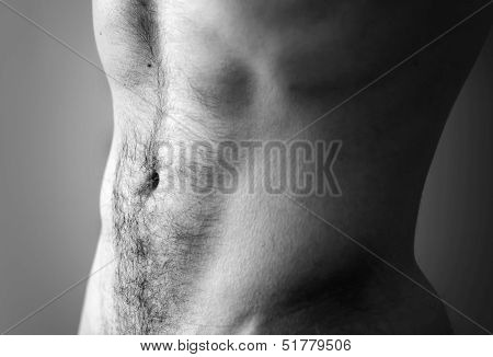 Flat Sporty Male Belly. Closeup Black And White Photo With Shallow Depth Of Field