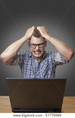 Aggressive Boy Sitting At The Computer