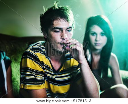 smoking a joint at party
