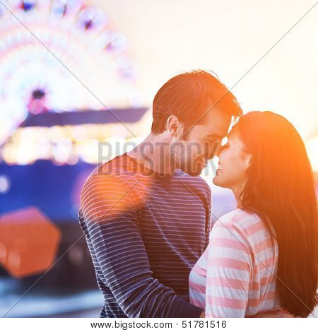 romantic couple with santa monica pier in background.